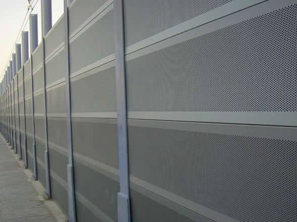 A highway sound barrier made from aluminum perforated panel.