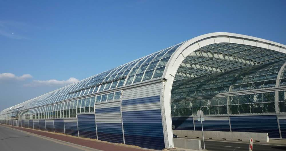 This is a combination of transparent and PVC sound barrier installed at railway station.